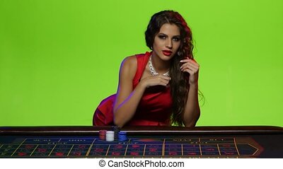 Beautiful brunette girl wants to play with you in poker,...
