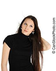 beautiful brunette girl wearing black dress looks up