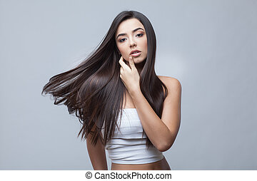 Hair. Beautiful Brunette Girl. Healthy Long Hair. Beauty Model Woman. Hairstyle. Hair care