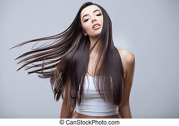 Beautiful Brunette Girl with Healthy Long Hair