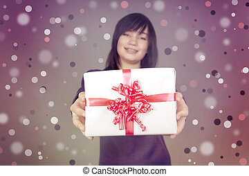 Beautiful brunette girl with present box in the hands