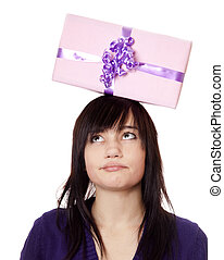 Beautiful brunette girl with present box over head.