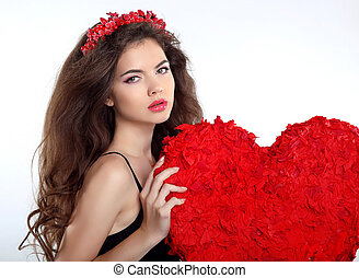Beautiful brunette girl with red heart gift for Valentines Day. Beauty portrait of young woman with chaplet isolated on white background.