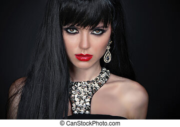 Beautiful Brunette Girl with red lips. Healthy Long Hair isolated on black