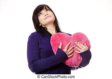 Beautiful brunette girl with toy heart.