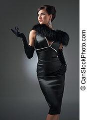 beautiful brunette in a black dress