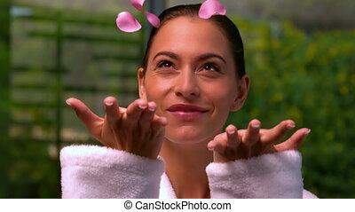 Beautiful brunette in bathrobe at spa