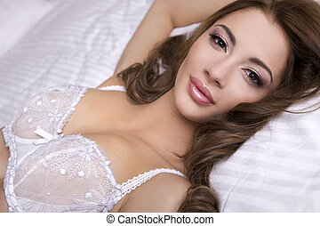 beautiful brunette in bed - Beautiful young blonde woman in...