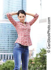 beautiful brunette in blue jeans