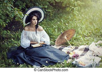 beautiful brunette in dress reading a book