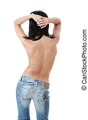 Beautiful brunette in jeans topless