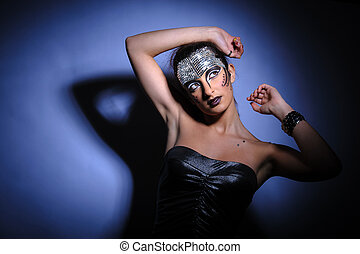 beautiful brunette in strong pose with hard light