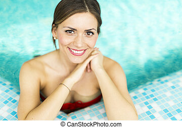 Beautiful brunette in the pool
