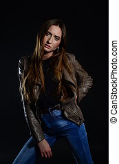 beautiful brunette in the studio on a black background