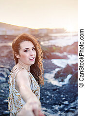 Beautiful brunette lady in a tropical paradise