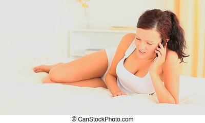 Beautiful brunette making a phone c