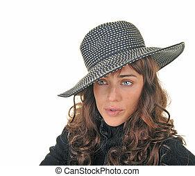 Beautiful brunette model on wearing a hat.