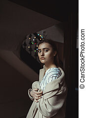 Beautiful brunette model posing in the dark room