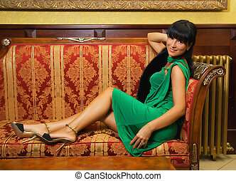 Beautiful brunette on a luxury sofa