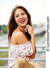 Beautiful brunette over summer background