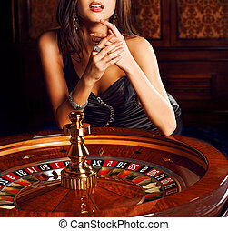 Beautiful brunette plays in casino - Beautiful brunette in...