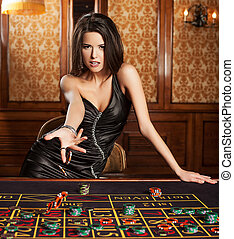 Beautiful brunette plays in casino. photo - brunette girl in...