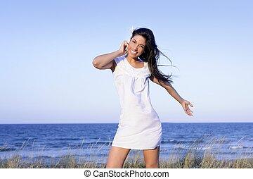 Beautiful brunette posing on the beach