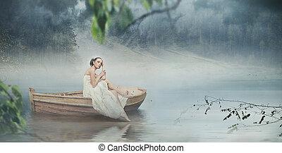 Beautiful brunette posing over beautiful romantic landscape - panoramic version