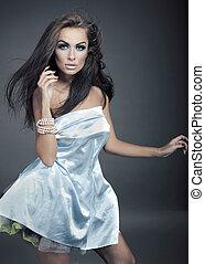 Beautiful brunette posing over studio background