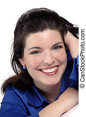 Pretty Brunette Young Woman Smiling, Wearing Blue Shirt And Earrings