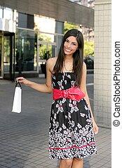 Beautiful brunette shopaholic outdoor city - Beautiful...