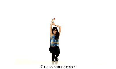 Beautiful brunette shows dancing lady style moves on white background