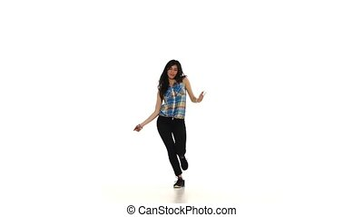 Beautiful brunette shows dancing lady style moves on white background, slow motion