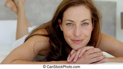 Beautiful brunette smiling at camer