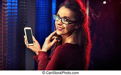 Beautiful brunette taking a selfie