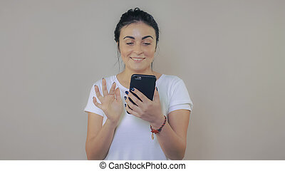 beautiful brunette using mobile phone