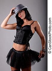 beautiful brunette wearing a black tutu