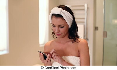 Beautiful brunette wearing a towel