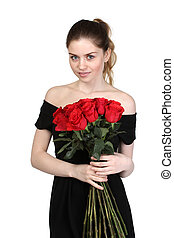 Beautiful brunette with a bouquet of roses