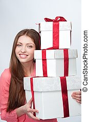 Beautiful brunette with a gift boxes.