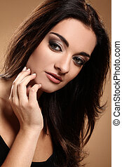 Beautiful brunette with evening makeup