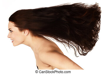 beautiful brunette with long flying hair