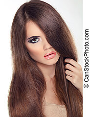 Beautiful brunette with long hair and makeup isolated on ...