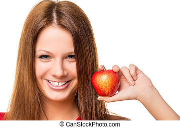 Beautiful brunette with red apple, close-up portrait isolated