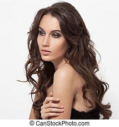 Beautiful Brunette Woman. Curly Long Hair.