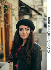 beautiful brunette woman dressed in retro style