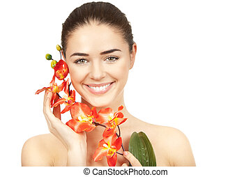 Beautiful brunette woman holding branch of orchid