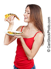 beautiful brunette woman holding piece of pizza