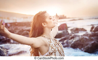 Beautiful brunette woman in a tropical paradise
