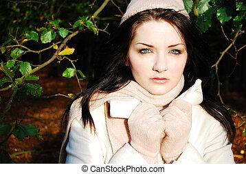 Beautiful brunette woman in autumn/winter scene